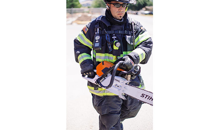 Firefighter with Chainsaw